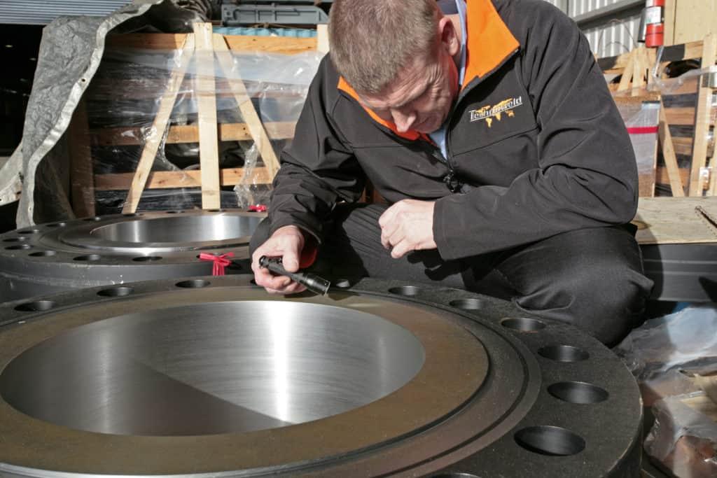 man conducting welding inspection